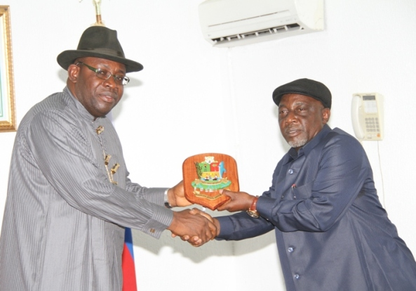 Bayelsa State Governor, Hon. Seriake Dickson (left) presenting a souvenir to the Hon. Minister of Interior, Comrade Abba  Moro (right) during a courtesy call at Government House in Yenagoa. Photo by Lucky Francis