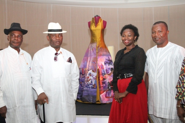 From L – R: Executive Secretary/CEO, National Institute for Cultural Orientation (NICO), Abuja, Dr. Barclays Ayakoroma, Bayelsa State Deputy Governor, Rear Admiral John Jonah (Rtd), an International Exhibitor, Patience Torlowei of Bayelsa State, and the Bayelsa State Commissioner for Culture & Ijaw National Affairs, Dr. Felix Tuodolor, during the send-forth ceremony of the award winning dress 'Esther' ( at the background) designed by Patience Torlowei, to the Smithsonian National Museum of African Art, Washington DC, at the Banquet hall, Government House, Yenagoa. Photo by Michael Owi.